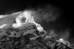 Wind blowing snow off Mount Kidd