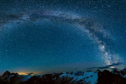 Milky Way arc over mountains and glaciers in Rogers Pass, British Columbia