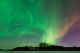 Northern lights in moonlit sky Alberta