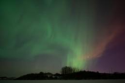 Aurora Borealis in moonlit sky Alberta