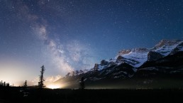 Milky Way over Mount Rundle, a CP Rail train lights up the foreground