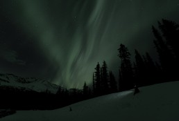 Bright aurora borealis edited to show what the human eye might see in the dark