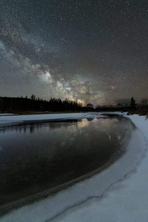 Milky Way Rising over a still river and Chief Mountain