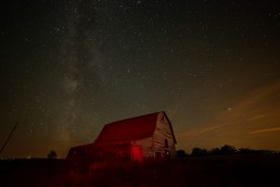 Milky Way image with red barn before editing