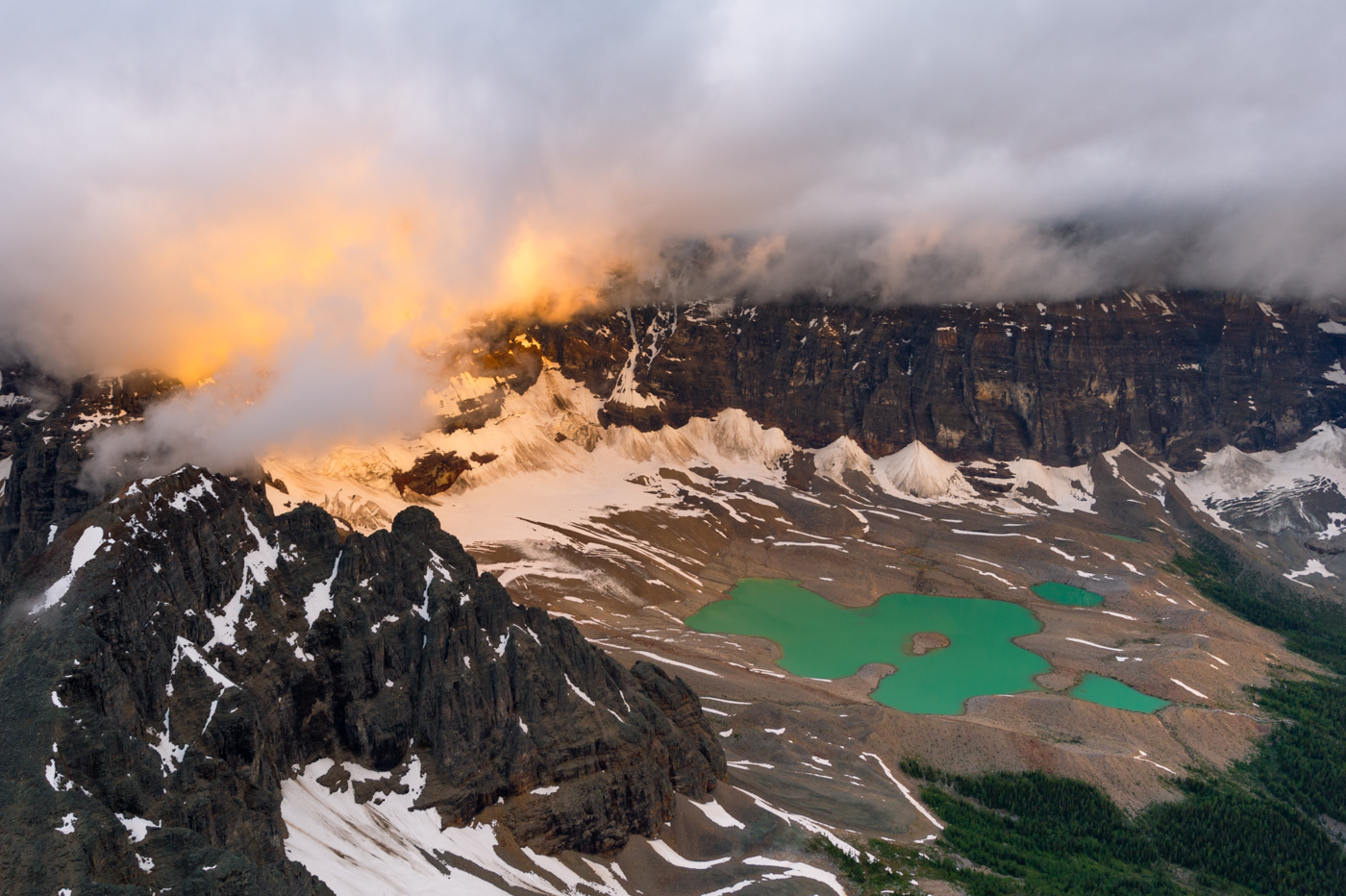 Fiery clouds over horseshoe lake in Banff National Park