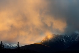 Yellow clouds lit up by sunset in Jasper National Park