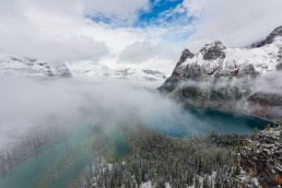 Mist flowing over Lake Ohara from Opabin Plateau