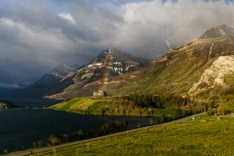 Rainbow rising from the Prince of Wales hotel on a stormy morning in Waterton
